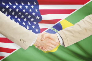 Businessmen shaking hands - United States and Brazil